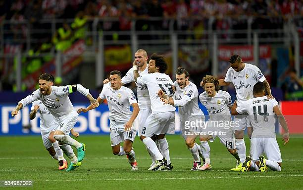 Real Madrid players celebrate after winning the penalty shoot out during the UEFA Champions League Final match between Real Madrid and Club Atletico...