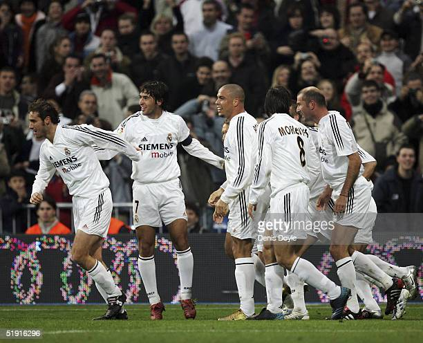 Real Madrid players celebrate after Zinedine Zidane scored a penalty during the Primera Liga match against Real Sociedad at the Bernabeu on January 5...