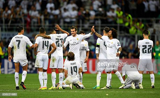 Real Madrid players celebrate during the penalty shoot out at the UEFA Champions League Final match between Real Madrid and Club Atletico de Madrid...