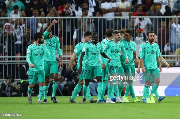 Real Madrid players celebrate the first goal scored by Toni Kroos of Real Madrid during the Supercopa de Espana SemiFinal match between Valencia CF...