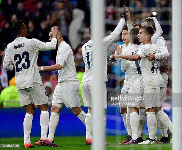 Real Madrid players celebrate the opening goal during the Spanish league football match Real Madrid CF vs Real Sporting de Gijon at the Santiago...