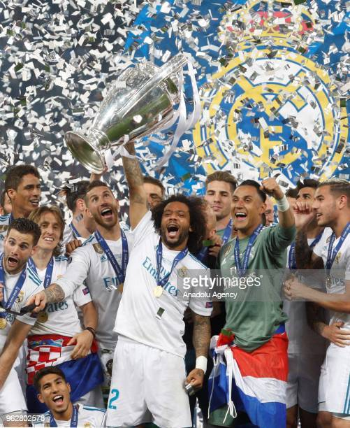 Real Madrid players celebrate the victory after winning against Liverpool FC in the UEFA Champions League final football match at the Olimpiyskiy...