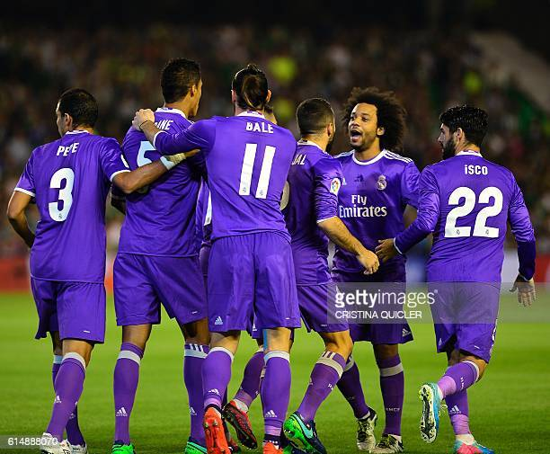 Real Madrid players celebrate their opener during the Spanish league football match Real Betis vs Real Madrid CF at the Benito Villamarin stadium in...