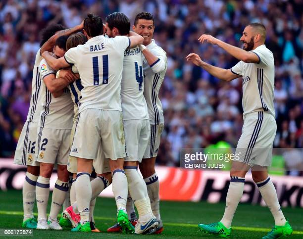 Real Madrid players celebrate their opening goal during the Spanish league football match Real Madrid CF vs Club Atletico de Madrid at the Santiago...