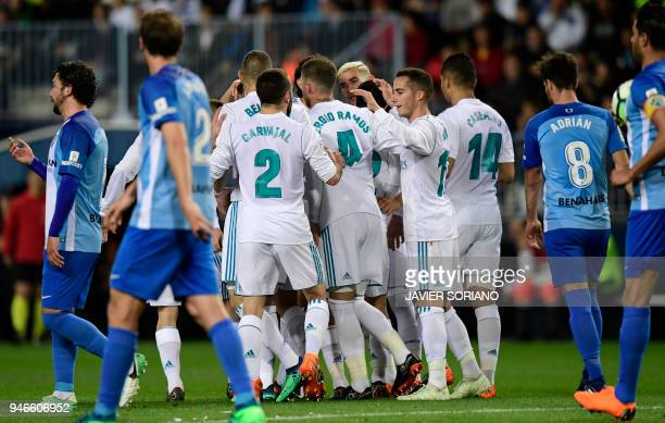 Real Madrid players celebrate their opening goal during the Spanish league footbal match between Malaga CF and Real Madrid CF at La Rosaleda stadium...