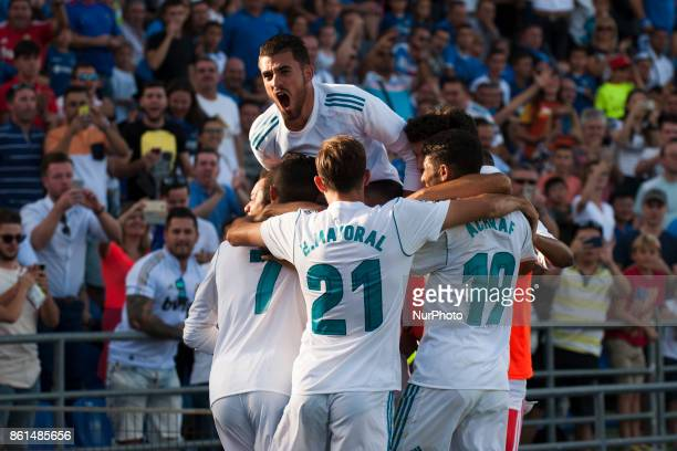 Real Madrid players celebrate their second goal during the Spanish league football match Getafe CF vs Real Madrid CF at the Col Alfonso Perez stadium...