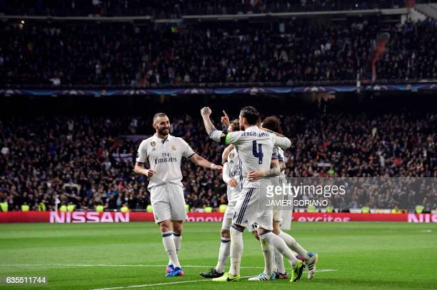Real Madrid players celebrate their second goal during the UEFA Champions League round of 16 first leg football match Real Madrid CF vs SSC Napoli at...