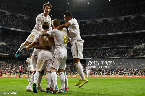 Real Madrid players celebrate their second goal scored by Real Madrid's Brazilian forward Rodrygo during the Spanish league football match between...