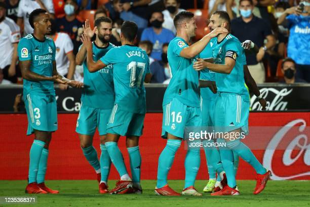 Real Madrid players celebrate their second goal scored by Real Madrid's French forward Karim Benzema during the Spanish League football match between...