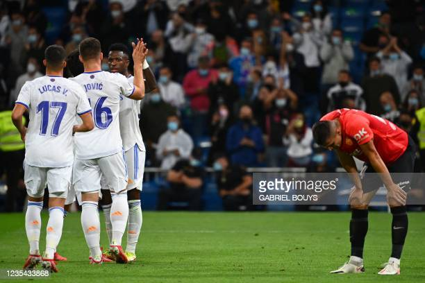 Real Madrid players celebrate their sixth goal scored by Real Madrid's Spanish midfielder Isco during the Spanish League footbal match between Real...