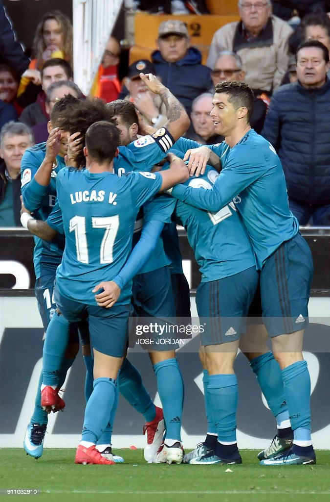 Real Madrid players celebrate their third goal during the Spanish league football match between Valencia CF and Real Madrid CF at the Mestalla stadium in Valencia on January 27, 2018. /