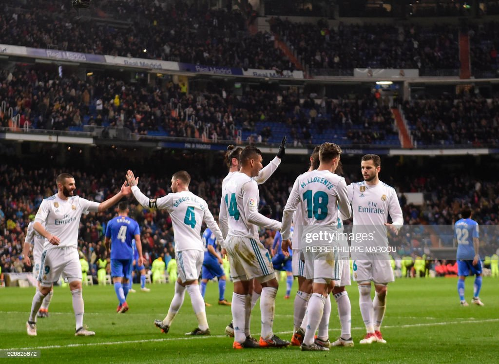 Real Madrid players celebrate their third goal during the Spanish league football match Real Madrid CF against Getafe CF at the Santiago Bernabeu stadium in Madrid on March 3, 2018. /