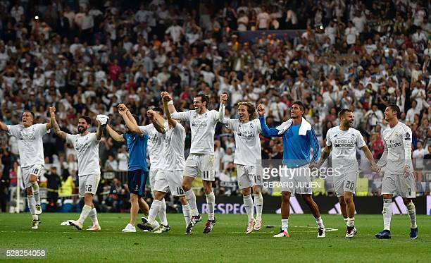 Real Madrid players celebrate their victory at the end of the UEFA Champions League semifinal second leg football match Real Madrid CF vs Manchester...