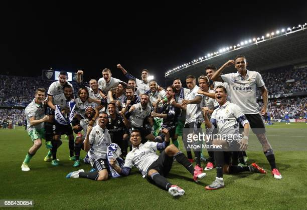 Real Madrid players celebrate winning the La Liga title following the La Liga match between Malaga CF and Real Madrid CF at Estadio La Rosaleda on...