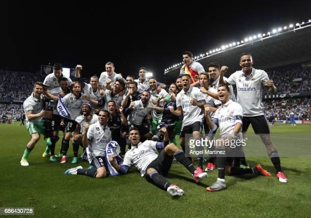 Real Madrid players celebrate winning the La Liga title following the La Liga match between Malaga CF and Real Madrid CF at Estadio La Rosaleda on...