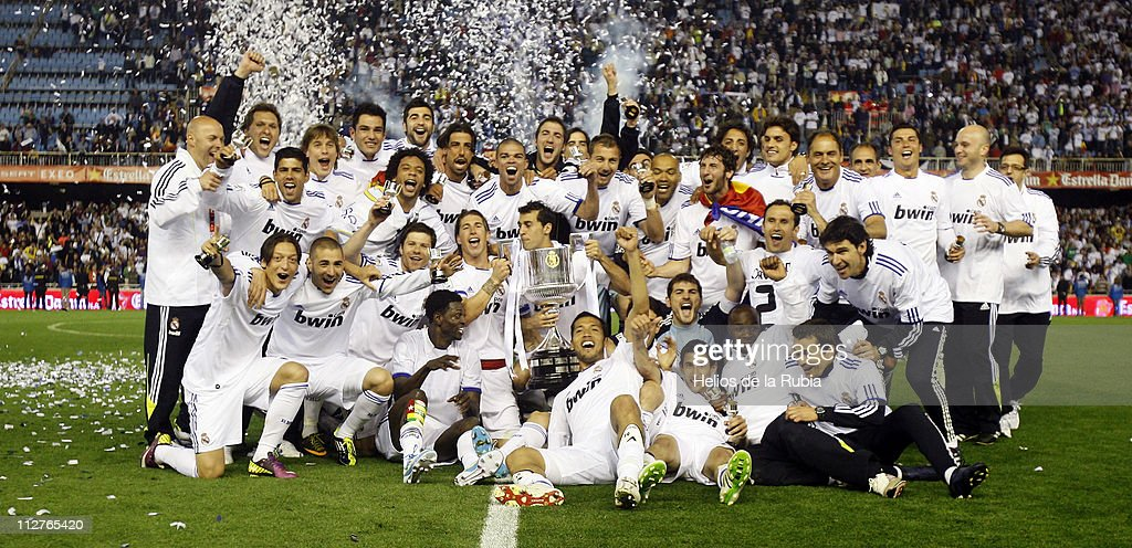 Real Madrid players celebrate with the Copa del Rey trophy after the Copa del Rey Final between Barcelona and Real Madrid at Estadio Mestalla on April 20, 2011 in Valencia, Spain.