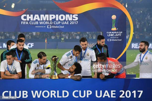 Real Madrid players celebrate with the FIFA Club World Cup trophy following their victory in the final football match against Gremio at Zayed Sports...