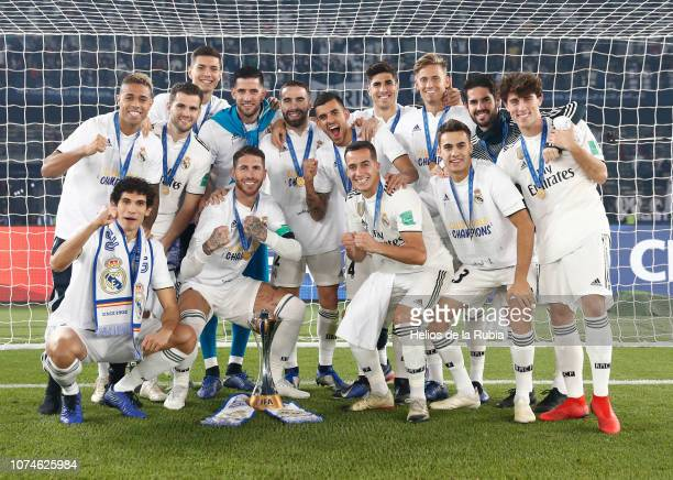 Real Madrid players celebrate with the trophy after the end of the FIFA Club World Cup Final soccer match between Spain's Real Madrid and UAE's Al...