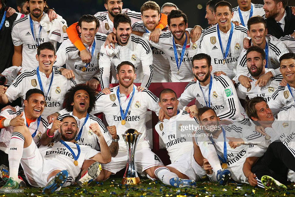 Real Madrid players celebrate with the trophy after the FIFA Club World Cup Final between Real Madrid and San Lorenzo at Marrakech Stadium on December 20, 2014 in Marrakech, Morocco.
