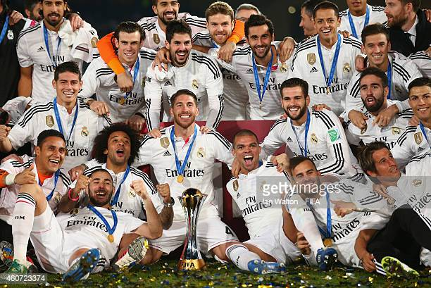 Real Madrid players celebrate with the trophy after the FIFA Club World Cup Final between Real Madrid and San Lorenzo at Marrakech Stadium on...