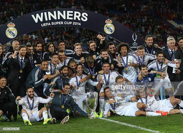 Real Madrid players celebrate with the trophy during the UEFA Super Cup match between Real Madrid and Sevilla at Cardiff City Stadium on August 12...