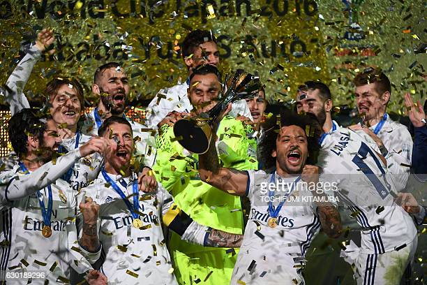 Real Madrid players celebrate with their trophy after winning the Club World Cup football final match against Kashima Antlers of Japan at Yokohama...