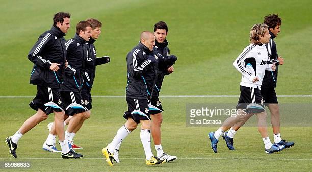 Real Madrid players Christoph Metzelder Rafael Van der Vaart Klaas Jan Huntelaar Fabio Cannavaro Miguel Torres Michel Salgado and Raul Gonzalez run...