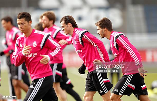 Real Madrid players Cristiano Ronaldo Gareth bale and Lucas Silva warm up during a training session at Valdebebas training ground on January 26 2015...