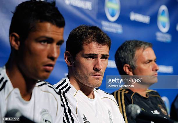 Real Madrid players Cristiano Ronaldo goalkeeper Iker Casillas and coach Jose Mourinho during a news conference to announce the Herbalife World...