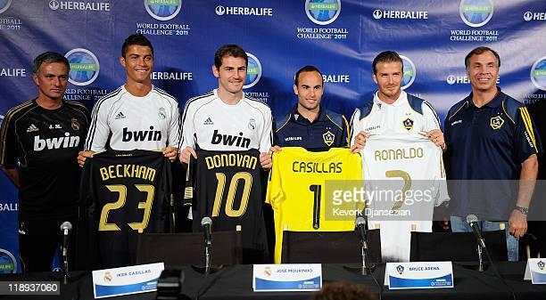 Real Madrid players Cristiano Ronaldo goalkeeper Iker Casillas and coach Jose Mourinho pose with Los Angeles Galaxy players Landon Donovan David...