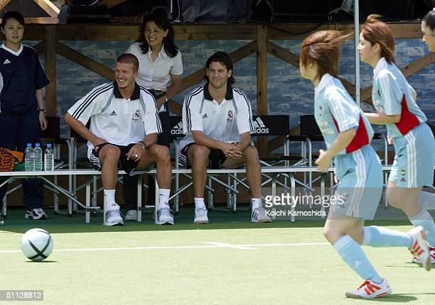 Real Madrid players David Beckham and Santiago Solari watch play from the sidelines of an adidas sponsered Japanese girls fiveaside Futsal event on...