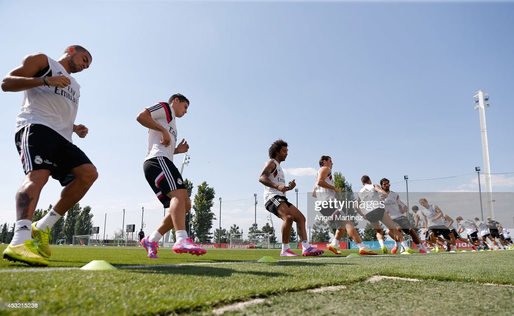 Real Madrid players exercise during a training session at Valdebebas training ground on August 5, 2014 in Madrid, Spain.