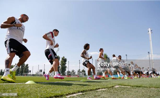 Real Madrid players exercise during a training session at Valdebebas training ground on August 5 2014 in Madrid Spain