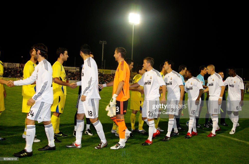 Real Madrid players greet Alcorcon players before the Copa del Rey match between AD Alcorcon and Real Madrid at Municipal de Santo Domingo on October 27, 2009 in Alcorcon, Spain.