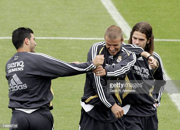 Real Madrid players Jose Antonio Reyes and Fernando Gago fool around with David Beckham during a training session on June 16 2007 in Madrid Spain