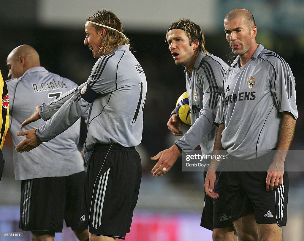 Real Madrid players Jose Maria Gutierrez (L) David Beckham and Zinedine Zidane (R) argue with the referee during a Primera Liga match between Real Sociedad and Real Madrid at the Anoeta stadium on November 27, 2005 in San Sebastian, Spain. The match ended a 2-2 draw.