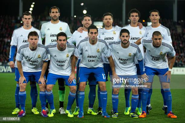 Real Madrid players line up wearing tshirts in support of their injured teammate Sami Khedira prior to start the La Liga match between UD Almeria and...