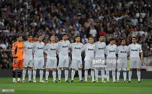 Real Madrid players observe a minute of silence for the victems of the plane crash that killed Poland's president Lech Kaczynski his wife Maria and...