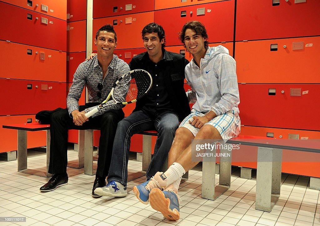 Real Madrid players Portuguese Cristiano Ronaldo (L) and Spain Raul Gonzalez (C) pose with Spain's Rafael Nadal during the Madrid Master at the Caja Magic sports complex on May 12, 2010 in Madrid.