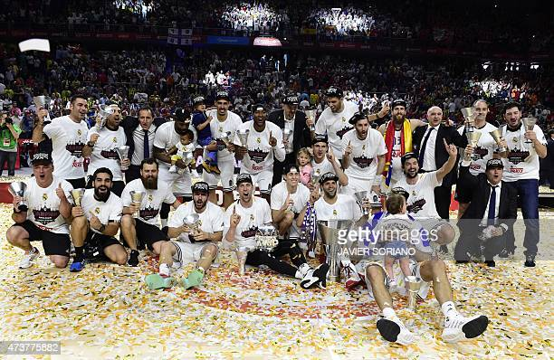 Real Madrid players pose after winning the Euroleague Final Four basketball final against Olympiacos Pireus at the Palacio de los Deportes in Madrid...