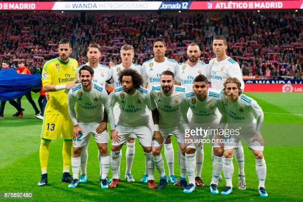 Real Madrid players pose before the Spanish league football match Atletico Madrid vs Real Madrid at the Wanda Metropolitan stadium in Madrid on...