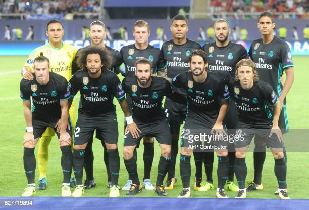Real Madrid players pose for a photograph prior to the UEFA Super Cup football match between Real Madrid and Manchester United on August 8 at the...