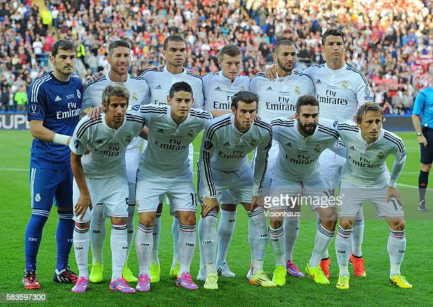 Real Madrid players pose for a team photograph before the UEFA Super Cup Final between Real Madrid CF and Sevilla FC at the Cardiff City Stadium in...