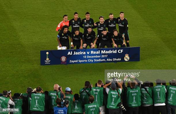 Real Madrid players pose for a team photograph during the FIFA Club World Cup UAE 2017 semi final match between Al Jazira and Real Madrid CF at Zayed...