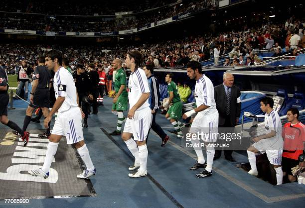 Real Madrid players Raul Gonzales Sergio Ramos Miguel Torres Javier Saviola and Iker Casillas get into the field before the La Liga match between...