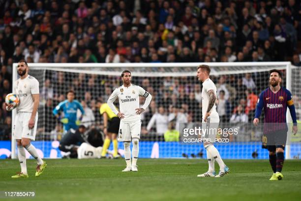 Real Madrid players react to Barcelona's second goal during the Spanish Copa del Rey semifinal second leg football match between Real Madrid and...