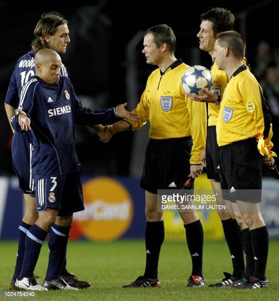 Real Madrid players Roberto Carlos and Jonathan Woodgate thank referee Wolfgang Stark and assistant referees Peter Henes and Markus Scheibel after...