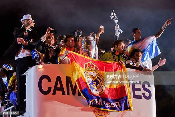Real Madrid players Sergio Ramos Cristiano Ronaldo Pepe Marcelo and Angel Di Maria greets the audience as they hold the UEFA Champions League cup...