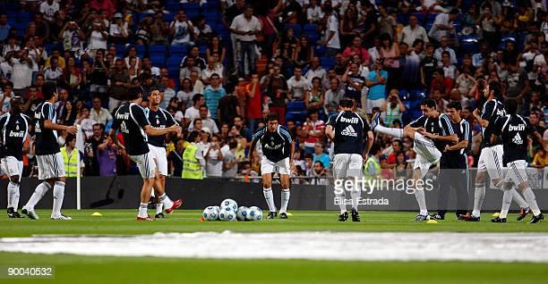 Real Madrid players stretch before the Santiago Bernabeu Trophy match at Estadio Santiago Bernabeu stadium on August 24 2009 in Madrid Spain