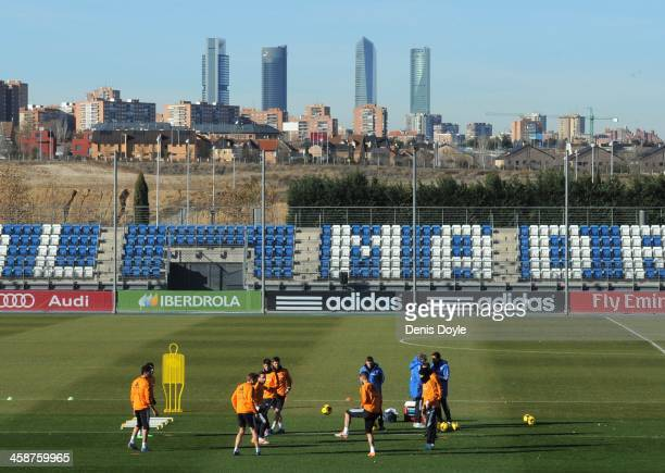 Real Madrid players train at the Valdebebas training ground with the Madrid Four Towers skyscrapers in the background on December 21, 2013 in Madrid,...